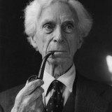 Bertrand Russell smoking a pipe.